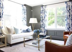 Gray walls and floral curtains