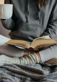 Cosy fall and winter vibes. Celebrate hygge with a book and a cup of hot chocolate.