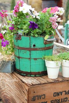 turquoise bucket vase--looks like an old ice cream freezer