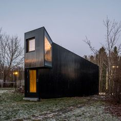 Jarmund/Vigsnæs has designed a small wooden cabin at the end of a garden in Oslo with an angular form that frames different views of its surroundings