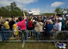 April 19, 2012. Space Shuttle Discovery Arrives at the Udvar-Hazy Center via tow from adjacent Dulles Airport. She is escorted by 15 Commanders of Discovery missions and shuttle processing crews from NASA's Kennedy Space Center. Photo credit: (NASA/Carla Cioffi - 201204190013HQ)