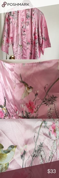 Japanese Kimono New.  Beautiful Japanese Kimono. Made of 100% Polyester.  Pink with birds and flowers pattern.  This was bought in Japan.  It is new and never been worn but does not come with tags. It is 40 inches long and has 2 pockets. Intimates & Sleepwear Robes