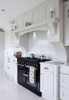 This bespoke over mantle by Dorans Kitchen & Home frames the range cooker and cr. - This bespoke over mantle by Dorans Kitchen & Home frames the range cooker and cr. Kitchen Mantle, Home Decor Kitchen, Diy Kitchen, Cheap Kitchen, Kitchen Chimney, 10x10 Kitchen, Kitchen Ideas, Kitchen Cooker, Kitchen Stove
