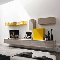 Contemporary TV unit composition Paola by Siluetto, features 4 wall mounted base units, 3 wall mounted cupboard units and a wall mounted bookshelf