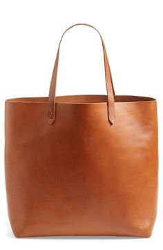 Madewell 'The Transport' Leather Tote at Nordstrom.com. An all-purpose tote fashioned from sleek genuine leather boasts a voluminous storage compartment and sturdy straps that rest comfortably on your shoulder. This style is available in inky black or rugged brown and may be monogrammed for a personal finishing touch.
