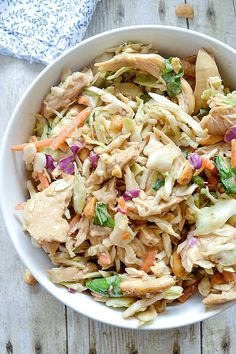 A simple recipe for Crunchy Thai Chicken Salad made with coleslaw, sesame ginger salad dressing and chicken tossed in a delicious peanut sauce.