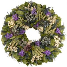 Blue Meadow Mist Wreath designed with pockets of phalaris, white ammobium, natural blue hydrangea, globe thistle accented with fern and salal leaves.