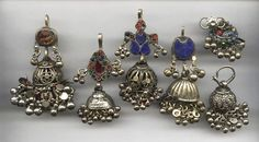 India    Kuchi tribal jhumka/jumpka style earrings/temple domes.  Often hung to each side of the face from a headdress or scarf.
