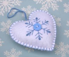 Felt Christmas Ornament Scandinavian Heart ornament Felt heart decorationEmbroidered Snowflake heart Holiday decor Handmade felt heart by PuffinPatchwork on Etsy Felt Christmas Decorations, Felt Christmas Ornaments, Handmade Ornaments, Handmade Felt, Handmade Christmas, Christmas Diy, Holiday Decor, Quilling Christmas, Glitter Ornaments