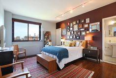 Contemporary Master Bedroom with Track lighting, Kennebunk home camelot decorative throw, Hardwood floors, specialty door