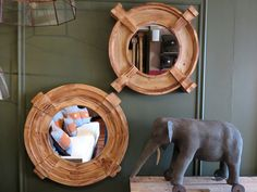 Round Wood Wall Mirror -  This might be a stretch but what does a round wood wall mirror have in common with an elephant. They both are considered keystones. This mirror is made with keystone construction which is an architectural term used to describe a decorative piece that is fitted at the apex of an arch. This is most commonly found in window trim and moldings. But we like the design effect it adds to this round wood mirror. Now to the elephant. Round Wood Wall Mirror Ele