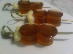Long Island Iced Tea Jelly Shots, skewered and sassy with a lemon peel