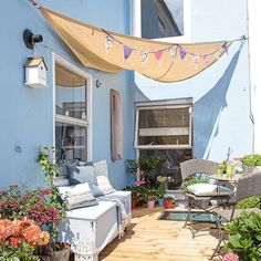 If you have a compact patio garden that's a bit of a sun trap, but you don't want to lose valuable space to a parasol (for that little bit of safe shade), consider hanging a simple sail-like canopy.  If you don't want to attach it to your masonry, many of these canopies can be raised on slender poles that sit at the sides of the space, rather than in the middle. Prepare to bring the seaside to the garden.
