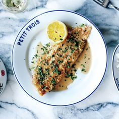 Cooking a whole Dover sole like they do at Petit Trois is no easy task (and can turn into an expensive mistake). We modified the recipe using fillets instead; equally delicious—and no tears.