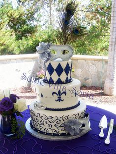 Mardi Gras Wedding Cake  Keywords: #mardigrasthemedweddings #jevelweddingplanning Follow Us: www.jevelweddingplanning.com  www.facebook.com/jevelweddingplanning