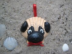 This adorable, carefully hand-painted Black and Tan Pug ornament is made entirely of seashells, most of which I collected myself from my favorite