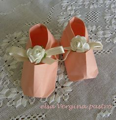 Origami pink shoes for a baby girl shower.