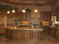 Mediterranean Kitchen with Ceiling fan by Carol Mickey | Zillow Digs