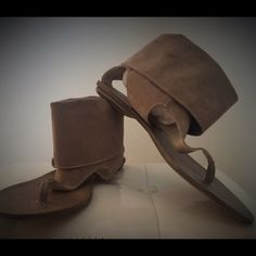 "Boutique 9 leather cuffed sandals Boutique 9 cuffed leather sandals. Genuine leather, man made. Size: 8M. Color: tan/gray. The cuff measures about 4"".  Note: they do have small signs of wear, see photos. Very chic! Like? Let's make a deal! Boutique 9 Shoes Sandals"