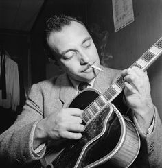 """Django Reinhardt was arguably the greatest guitarist who ever lived, an important influence on Les Paul, Charlie Christian, B.B. King, Jerry Garcia, Chet Atkins, and many others. Handsome, charismatic, childlike, and unpredictable, Reinhardt was a character out of a picaresque novel. Born in a gypsy caravan at a crossroads in Belgium, he was almost killed in a freak fire that burned half of his body and left his left hand twisted into a claw."