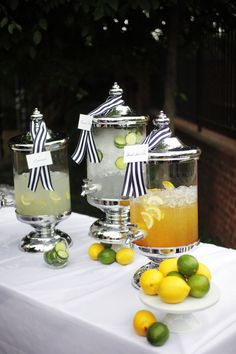 use cake stands for drink dispensers. love the tags with the ribbon