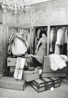 glamorous Italian actress Gina Lollobrigida packing for a trip