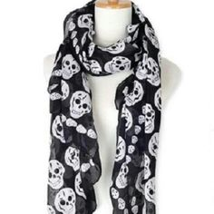 Skulls scarf GET SO STYLISH WITH THIS ITEM A MUST HAVE SCARF WEAR IT LIKE IT IS OR USE IT AS HAIR TIE. LIGHT AND FLOWY  I ACCEPT ALL OFFER PLEASE KINDLY USE THE OFFER BUTTON. THANK YOU  NIP NEW IN PACKAGE Accessories Scarves & Wraps