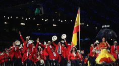 Swimmer Teresa Perales of Spain carries the flag of her nation