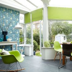 Decorate a modern conservatory with a striking teal wallpaper and contemporary accessories. Lime green blinds brighten up the space and help bring the outdoors in.
