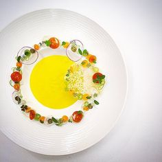 Saffron flavored potato cream soup with a garden salad by @tadashi_takayama #TheArtOfPlating