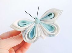 Pale blue and white silk butterfly brooch.