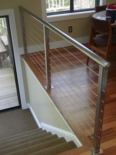 38 Edgy Cable Railing Ideas For Indoors And Outdoors Indoor Stair Railing, Staircase Railings, Banisters, Modern Staircase, Cable Stair Railing, Diy Stair, Deck Railings, Steel Railing, Wood Railing