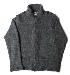 A casual shawl collar cardigan with a soft grey knit fabric. The washed mixed wool and acrylic sweater is great for layering and cozy for the fall season. $350