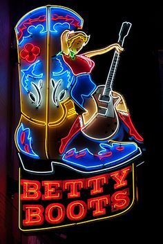 """""""Betty Boots"""" """"Cowboy Up"""" Neon signs dot downtown Nashville's Lower Broadway honky tonk scene. The area is ground zero for live music,honky tonks, and boot shops in Music City USA. The neon cowgirl at Betty Boots is an eye-catcher. Wall Art Prints, Canvas Prints, Vintage Neon Signs, Vintage Ads, Neon Nights, Neon Light Signs, Neon Glow, Old Signs, Wall Art Pictures"""