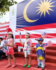 Kids in patriotic gear reflecting the Malaysian flag posing for photographs after the National Day parade in George Town Penang this morning.  Penang Malaysia | Aug 2016