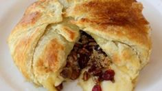 Brie topped with cranberries, toasted cinnamon pecans, and brown sugar all wrapped in a puff pastry. Perfect for your holiday gatherings.