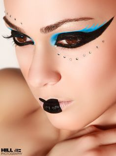 Dramatic eyes accented with crystals and bold lips.