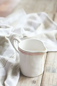 find a cute creamer cup from Goodwill or an antique shop ...... use it in the mudroom for a laundry scoop