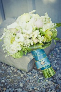 Below: Jennifer Elliotson of Mimosa Flower Studio brings the garden feeling into these stunning bouquet by using sprigs of lily-of-the-valley as an accent. Photos By: Mimosa Flower Studio