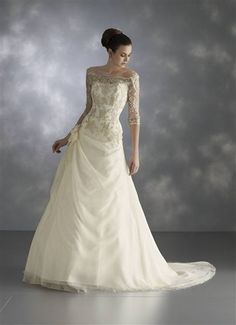 Charming white bridal gown with gold lace. Beautiful wedding dress.