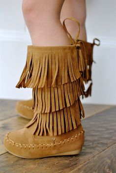 She'lltripleher style with these 3-LayerFringe Suede boots.Layered fringe styles a cute side-zip moccasin boot are perfect for fall fashion and keeping litte toes warm. The best thing about these shoes is slipping them on and off. Its the little things when your a mom of a toddler that you appreciate. Fits true to size.