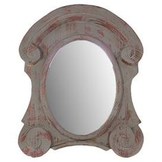 "Wall mirror with a weathered frame and scrolling detail.  Product: MirrorConstruction Material: Wood and mirrored glassColor: Distressed grayDimensions: 33.46"" H x 27.17"" W x 2.36"" D"