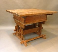 How intricate and amazing! A Rare 18th Century Swiss Trestle Table.   Made of golden colored pine with a deep lustrious patination.  This work table is a medieval gothic form that originated in the Alps in the 15th Century.  A very thick top conceals a dovetailed storage compartment over a complicated trestle base.  Made in Switzerland, circa 1720. $3200.00 #Hasteningdesignstudio #Swiss #Furniture #table #antique