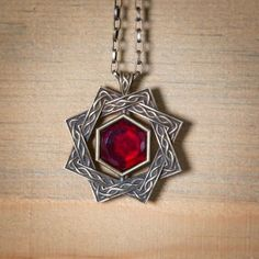 Amulet of The Bears Heart (crafted from giant blood and iron it is the highest honor in Goliath tribes, the Amulet grants the wearer immunity to poison and a +2 bonus to strength to a max of 22 Str.)