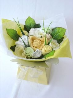 Baby Clothes Bouquet. So cute! baby-shower-ideas baby-clothes