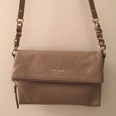 Kate Spade Crossbody Handbag Beige Kate Spade cross-body bag with fold over flap. Zipper compartment where the fold over is with magnetic closure to second compartment where there's an inside pocket. Navy striped lining. kate spade Bags Crossbody Bags