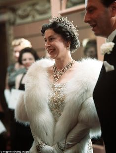 1962: Regal. Her Majesty adorned in jewels at the Royal Variety Performance