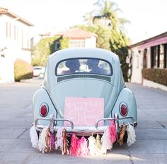 vw bug getaway car with pink tassel garland - yes!