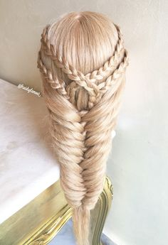 Double braid tieback into knotted fishtail braid