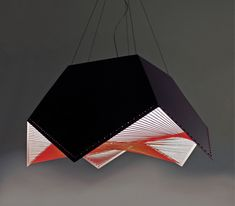 """'Saturn' by Outofstock  """"Saturn is a pendant lamp made of welded pentagonal shapes in aluminum alloy. Its clean geometric form contrasts with an undulating vortex of elastic threads under the lamp shade – a clash of order and disorder. The stitch-detail along the edges of the lamp lends a touch of hand-craftedness to the final product."""""""